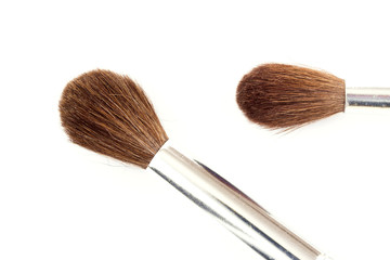 Closeup of two paintbrushes