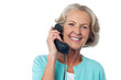 Senior lady holding phone receiver