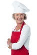 Cheerful confident aged female chef