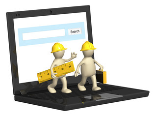 Two builders and laptop