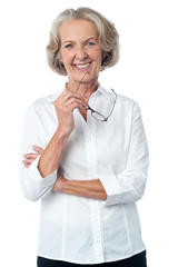 Smiling aged woman looking at you