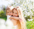 Mother and her little daughter in the spring day
