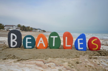 Beatles, colourful stones composition on the beach