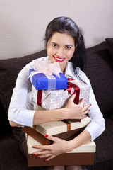 girl holds boxes of gifts
