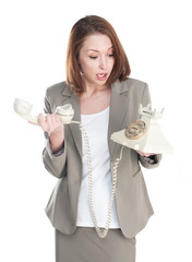 Funny business woman with vintage telephone isolated on white ba