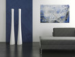 Black couch against blue and white wall