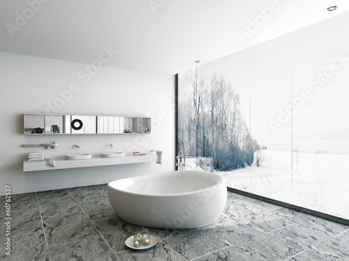 Luxury bathroom interior with bathtub and stone floor