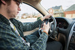 young man texting and driving distracted - 60763357