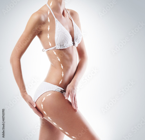 Body of a young and beautiful woman on a grey background