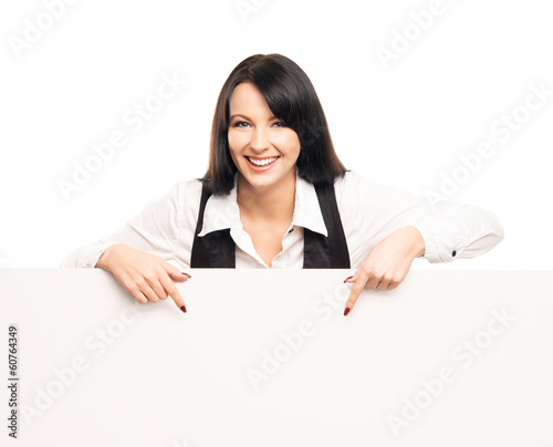 A successful and beautiful businesswoman with a blank billboard
