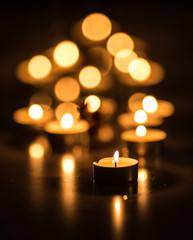 Candles on a dark background with bokeh