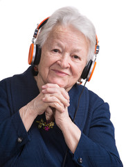 Old woman listening to music in headphones
