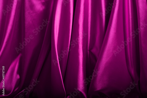 Pink silk background close up