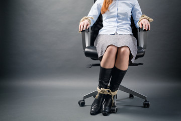 Tied Up Businesswoman in a Chair