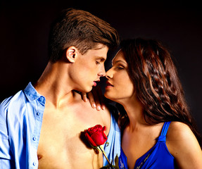 Beauty couple with rose flower.
