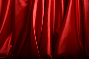 Red silk background close up