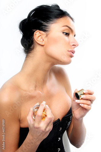 Beautiful brunette girl with perfume