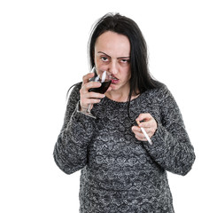 Alcoholic, woman drinking red wine from glass and smoking