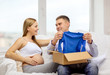 happy family expecting child opening parcel box
