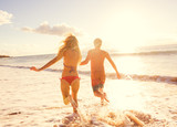 Fototapety Couple Enjoying Sunset on the Beach
