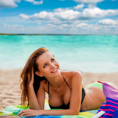 beautiful woman laying on beach