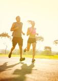 Fototapeta Couple running in park