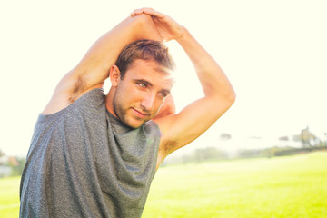 Attractive fit young man stretching