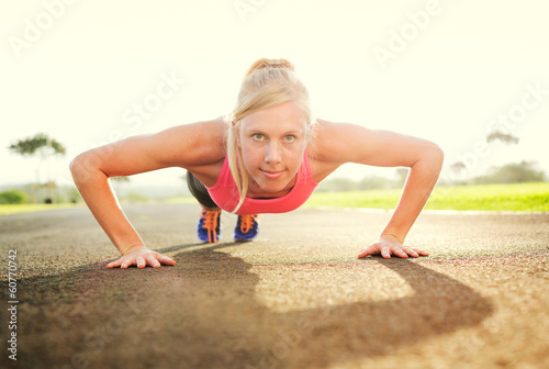 Attractive young woman doing push up