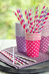 Colorful paper cups and striped straws