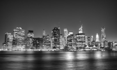 Black and white night view of Manhattan skyline