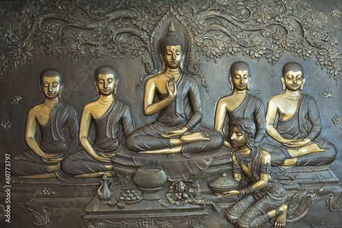 Buddha life scenes on carved metal at the temple in Thailand. - 60773797