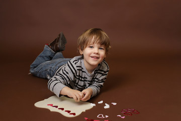 Child making Valentine's Day Craft with Hearts