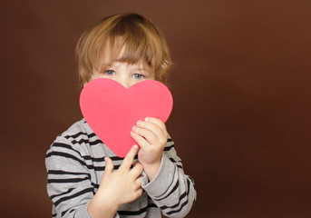 Child holding Valentine's Day Heart Sign