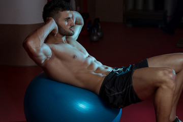 Men Working Out With An Exercise Ball