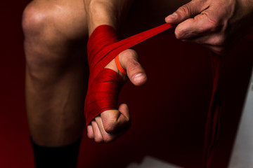 Boxer Putting On Straps Preparing For Combat