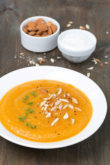 carrot soup with almonds and watercress, vertical
