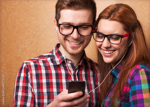 Young couple listening music together