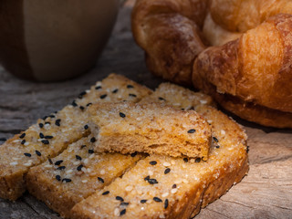 Freshly toasted salt and sesame bread,  croissant