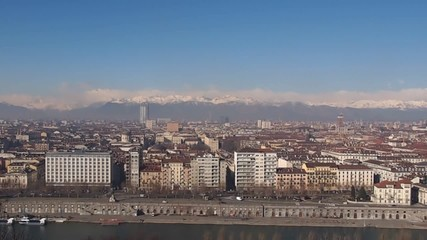 Panoramic panning view of Turin skyline seen from the hills