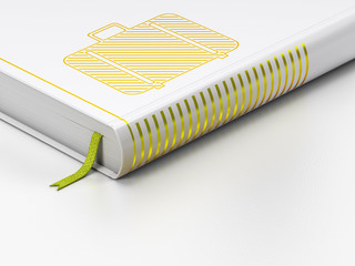 Tourism concept: closed book, Bag on white background