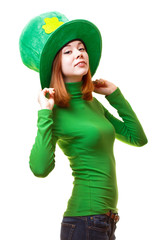 Red hair girl in Saint Patrick's Day leprechaun party hat