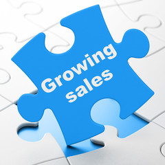 Finance concept: Growing Sales on puzzle background