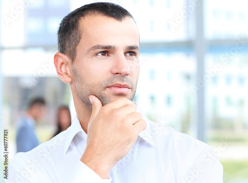 Thoughtful businessman. Handsome man thinking