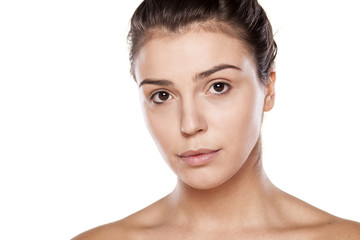 portrait of a young woman just with foundation on her face