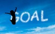 Composite image of goal written in white in sky