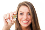 Happy woman holding euro coin on white background.