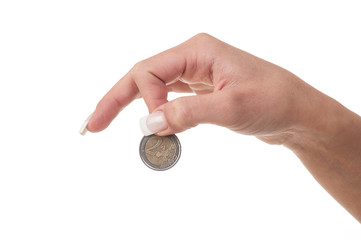 Detail of woman hand holding euro coin on white background.