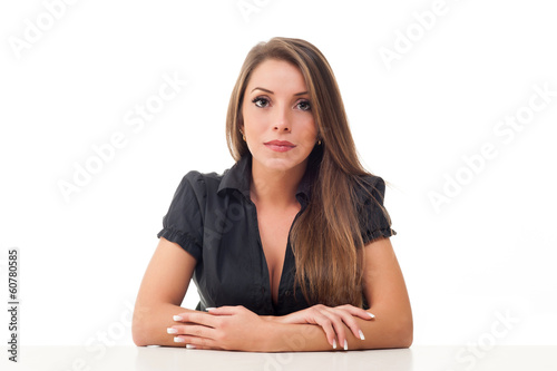 Satisfied businesswoman at the desk on white background.