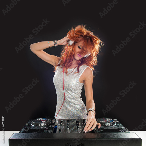 Young sexy deejay woman against black background.