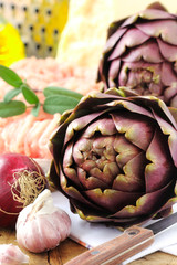 Fresh and uncooked stuffed artichoke ingredients